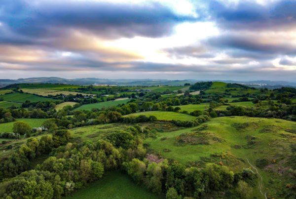Green hills with cloudy sky landscape, Cork Ireland